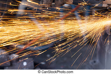 welding sparks closeup - photo orange sparks during the...