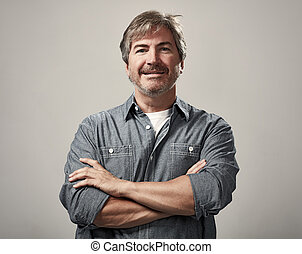 Man portrait - Smiling handsome man portrait over gray wall...