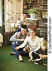 Portrait of happy family with their pet at home
