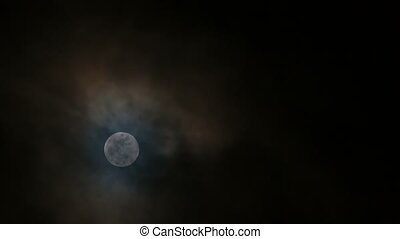 Time lapse of snow moon moonrise with dark clouds at night -...