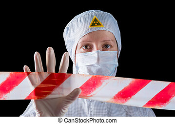 woman in protective clothing working in the infected area,...