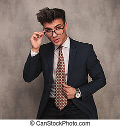 young business man taking off his glasses