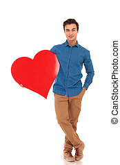 relaxed casual man holding big red heart