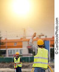 Civil engineers with theodolite - Surveyor engineers working...