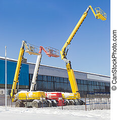 Three different self propelled wheeled boom lift with...