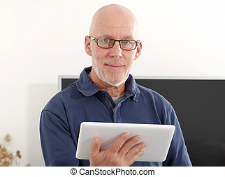 Mature man using a tablet