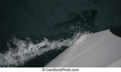 Bow of white yacht breaks of sea waves in Greece. Top view....