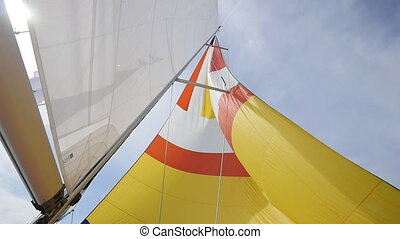 Sail and ropes of yacht on background of sky on the island...