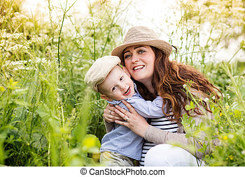 Beautiful pregnant mother with her cute little son. -...