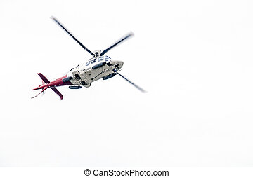 Airborn Helicopter Isolated Against White Overcast Sky -...