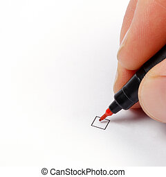 Hand with red pen ready to mark a checkbox