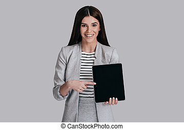 Look over here! Beautiful young woman in smart casual wear...
