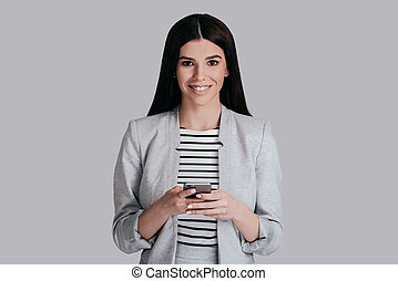 Receiving good news. Gorgeous young woman in smart casual...