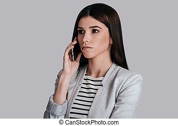 Business talk. Attractive young woman in smart casual wear...