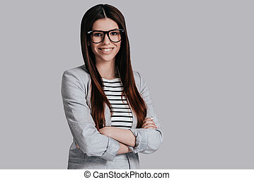 Confident and successful. Beautiful young woman in smart...
