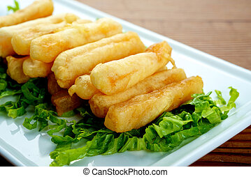 Chinese Fried Sweet Potatoes dish on white plate