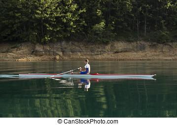 single rower at sunrise at the lake