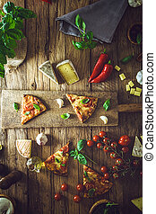 Pizza on wood with ingredients - Pizza slice on wood with...