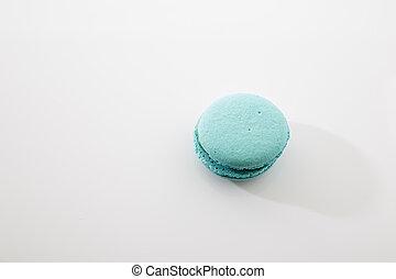 Tasty blue macaron isolated on white background