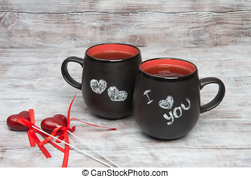 Two hearts and cup with the inscription in chalk I love you