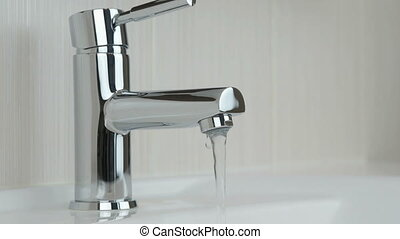 Weak flow of water pouring from chrome tap - Chrome-plated...