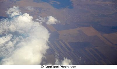 Airplane flying view from cabin landscape