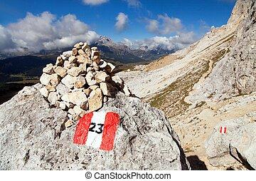 Tourist sign in Dolomites alps mountains, Italy - Tourist...