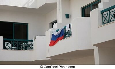 Russian flag on a balcony in Egypt at sunny day