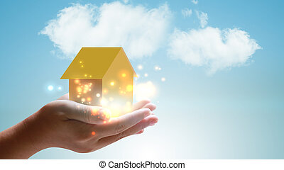 hands holding house. Real estate and property concept.