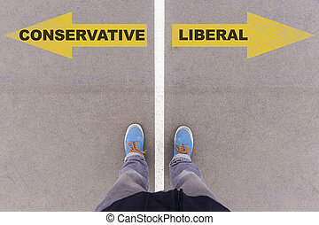 Conservative vs Liberal text arrows on asphalt ground, feet...