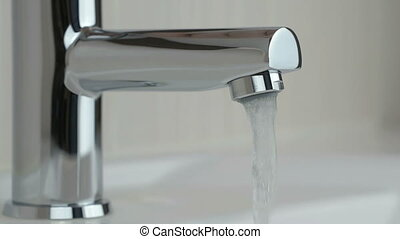 Water under strong pressure flows from a water tap