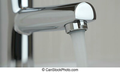 Water flows strong stream of chrome-plated faucet