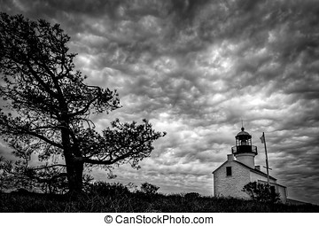 Hanging Clouds (B&W) - The old Point Loma lighthouse on an...