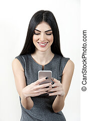 Businesswoman text messaging on cellphone - Young business...