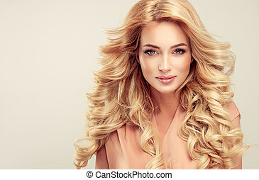 Attractive woman blonde with elegant hairstyle. Example of...