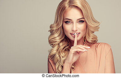 Smiling appealing lady with a secret. - Attractive woman...