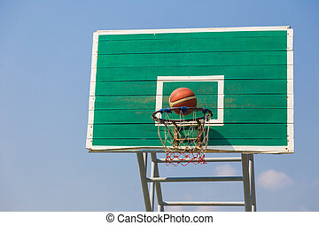 basketball fast moving into the basket at an outdoor field...