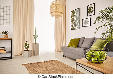 Bright room with earthy design and bowl of apples