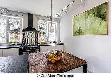 Modern kitchen with massive wooden table - Modern bright...
