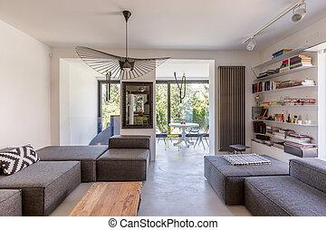 Modern living room overlooking veranda - Open space of a...