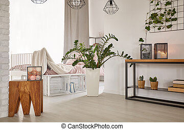 Room with minimalistic design and wooden decorations