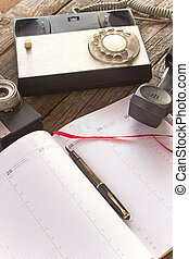 Fountain pen and notebook planner with telephone and camera