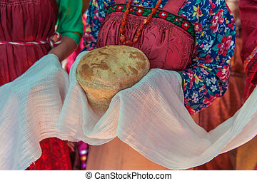 Russian old-fashioned wedding. Hands with bread, meeting...
