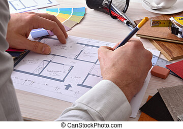 Designer developing a decoration project on your desk...