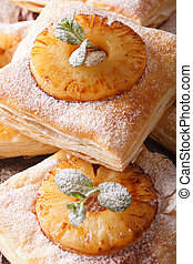 Delicious puff pastry pie with pineapple macro. vertical