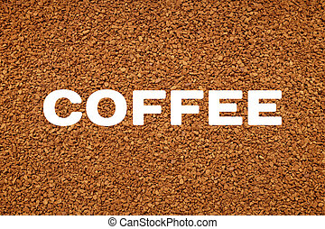 COFFEE text over background of freeze dried granules -...