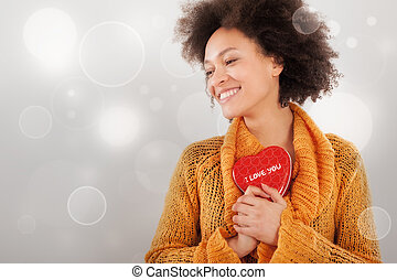 Beautiful young woman holding her gift box