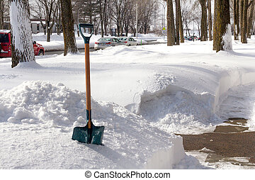 winter shoveling - view of a winter shovel on the frontyard...
