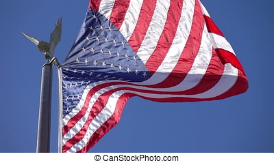 Video of United States flag waving in the wind - High...