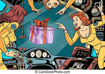 Women astronauts in the cabin of a spaceship and gift box....